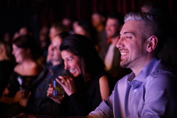 Laughing audience members